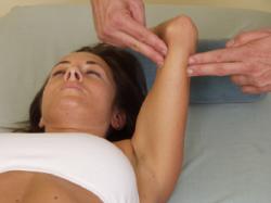 massaging a women's arm